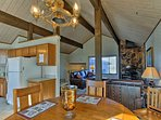 Enjoy delicious home-cooked meals at this quaint dining table, with seating for 6 people.