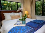 Take a peaceful rest, surrounded by tropical foliage while enjoying your own AC.