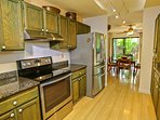 The beautiful kitchen flows into the dining area creating a lovely open space