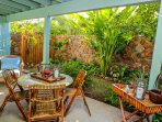 Ample seating as you play a card game or enjoy appetizers at this garden table