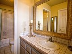 This tasteful en-suite bathroom features a tub and shower combination set.