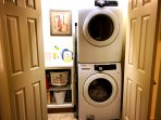 Full washer and dryer next to master bath. Iron and ironing board. Laundry detergent provided.