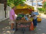 Vendor selling fruit & vegetables just behind the building!