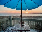 Enjoy the sunset and a glass of wine on the top floor patio!