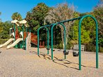 Great playground, with swings, slides, and a rock wall, for kids to play!