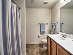 Double vanities and a shower/tub combo complete the en-suite bathroom.