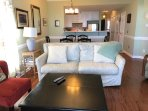 Living area flows from LR thru DR, kitchen-- its a socialable scheme with custom down/feather sofa