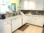 Superbly equipped kitchen with new quartz counters, sink and new stove