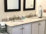 Master bath with twin sinks in new granite counter tops has shower and separate jacuzzi tub