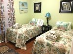 Twin beds with TV for game playing, accesses hall bath thru separate door