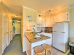 The kitchen comes complete with granite counters and a 2-person breakfast bar.