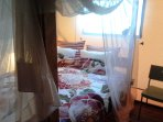 Romantic double bed. One of the 3 bedrooms.