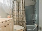 Stay fresh for daily adventures in this full bathroom with a shower/tub combo.