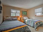 Bedroom 2 has a full bed and twin bed for restful slumbers.