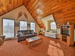 Walk into this cozy Ghent vacation rental cabin and ski out of it for a day on the slopes!