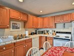 Modern appliances and ample countertops make home-cooking a breeze.