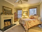 This elegant room features a cozy queen bed.