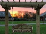 Watch the sun setting from the swing outside the door!