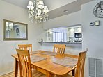 Enjoy your culinary creations at the 4-person wooden dining table.