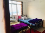 Twin sharing bedroom with balcony