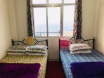 Twin sharing bedroom with balcony facing Kanchenjunga