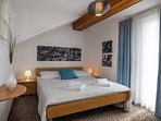lavish bedroom with comfortable double bed