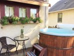 Hot tub on deck, close to back door.  Wonderful in winter!