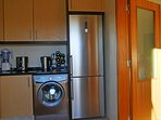 Kitchen with large fridge freezer and washing machine