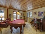 Lower Level Game room with wood stove, Flat Screened TV, pool table, bar area