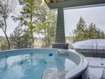 Hot Tub with river & mountain views off the lower level