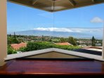 Corner window in living room shows off the views of the West Maui Mountains.