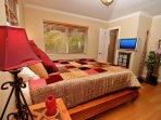 Master Bedroom has en-suite Bath with Travertine Walk-in Shower and HDTV/DVD.