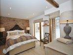 Enjoy a peaceful nights sleep in this rustic room