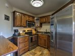 The kitchen is fully equipped with stainless steel appliances and ample counter space.