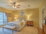 Wake up to sunrise views from the comfort of the master bedroom's king bed.