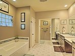 Luxury awaits in the en-suite with a large tub, walk-in shower & double vanity.