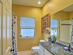 Wash up in the shower/tub combo and single vanity in the third full bathroom.