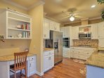 Utilize the stainless steel appliances and granite counters in the kitchen.