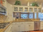 The kitchen opens into the living room through a breakfast bar for entertaining.