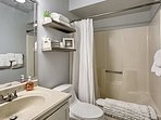 Wash up in the shower/tub combo and single vanity found in the first room's en-suite bath.