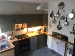 Well-equipped kitchen, with double gas oven and hob, dishwasher, microwave and fridge-freezer.