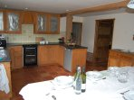 Well equipped kitchen with large dining table