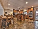 Fully Equipped Kitchen with Stainless Steel Appliances including Double Ovens, Island Bar Seating, Dining Area and...