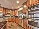 Fully Equipped Kitchen with Stainless Steel Appliances including Double Ovens and Granite Countertops