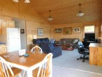 The comfortable living area is completely open, Cathedral windows face the river and state forest.