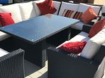 9 seater table and chairs to sit outside relaxing or eating alfesco.