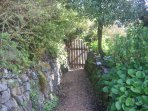 Private gate - beach path 8 mins to the right village shops and pubs to 14 mins the left.