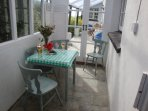 Small conservatory for catching winter sun or sea view over breakfast