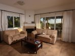 Sitting Area with Fire Place with Patio & Garden View