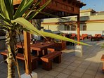 Benito's roof terrace garden. Equipped with dining furniture, BBQ facilities & sun loungers.